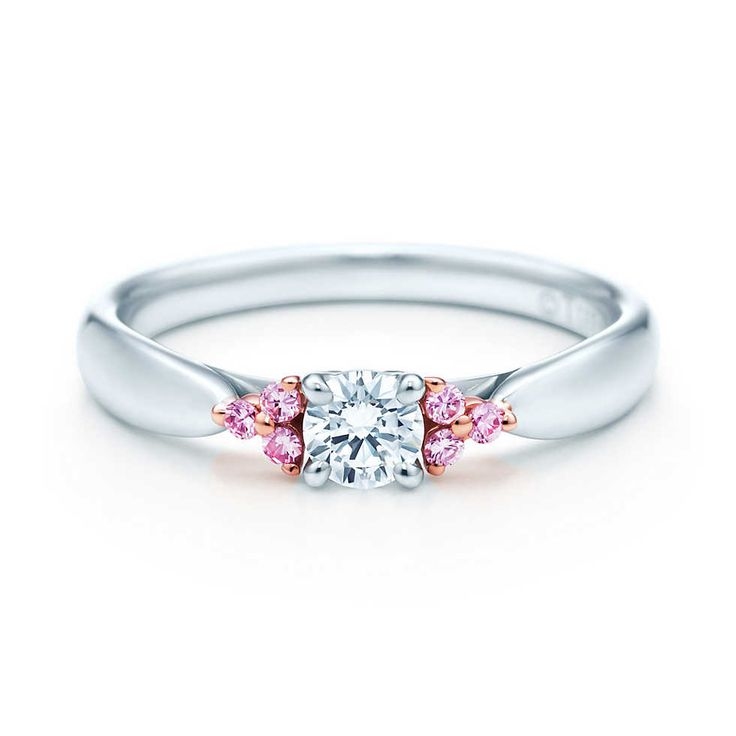 Tiffany Harmony Fancy Pink diamond side stone ring in rose gold and platinum.
