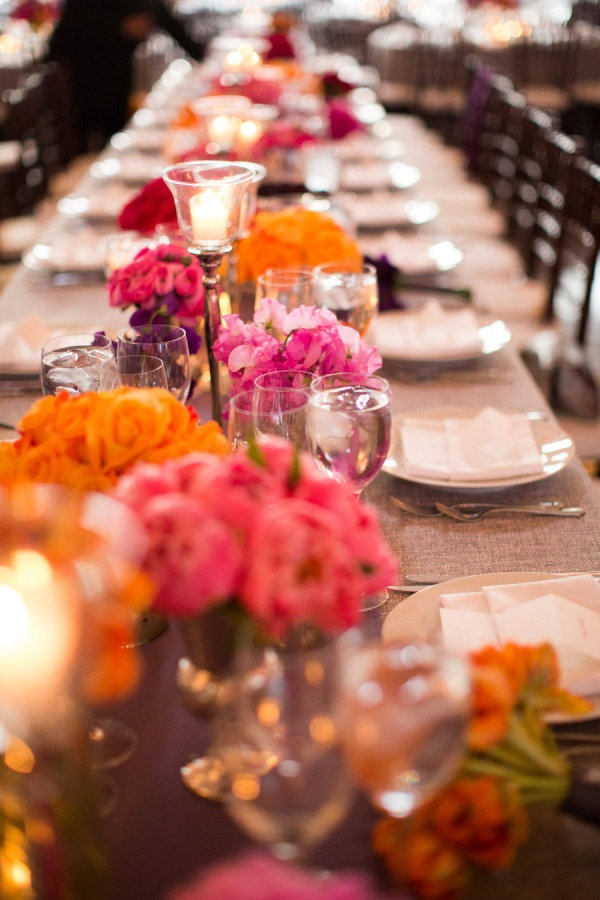 a table full of bright blooms  Photography by joeelariophotography.com, Design   Planning by lauraremmertevents.com, Planning by katieoevents.com, Floral   Event Design by fleurtaciousdesigns.com