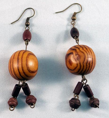These are gorgeous wooden earrings made of a main ball with beads attached to it. The earrings measure at 5.5 cm.
