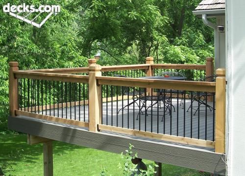 Deck with metal and wood posts and rails. I can totally see this off of my MBR! (With stairs to access a deck down below)