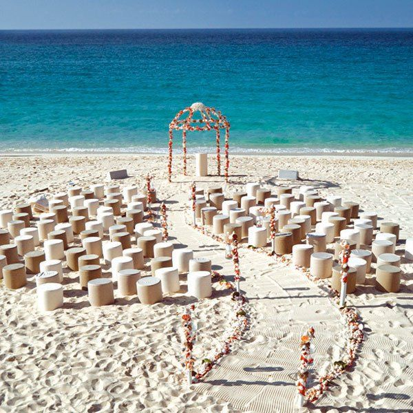 "Why We Love It: We love this whimsical set-up for a beach wedding ceremony!Why You Love It: ""I love the winding aisle, and the altar area and…"