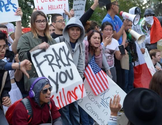 Protesters swarm supporters of Hillary Clinton at East Los Angeles College - Photos - UPI.com