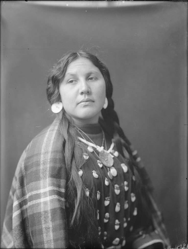 A portrait of a Crow woman. Collection Richard Throssel. Date Original: 1902-1933. University of Wyoming. American Heritage Center.