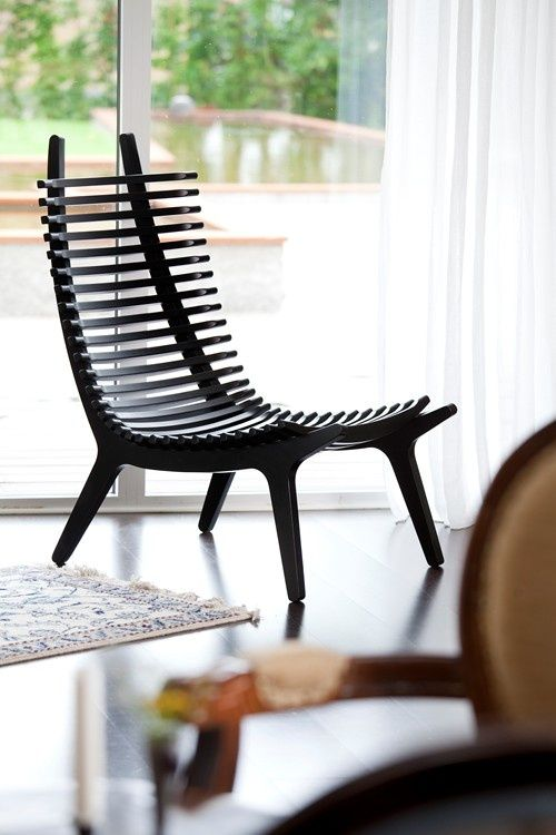Slatted Chair -very cool looking but is it comfortable? Worried my backside will look like it's been beaten with a lacrosse stick.