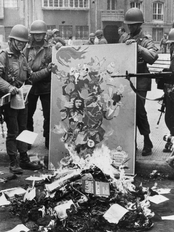 Soldiers burn Marxist books and leaflets in downtown Santiago, Sept. 23, 1973, some days after the military coup that ousted Chilean President Salvador Allende.
