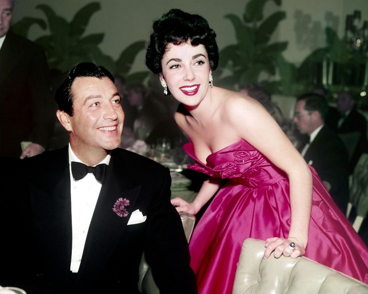 "Robert Taylor (1911-1969) and Elizabeth Taylor (1932-2011) at the after-party for the film premiere of ""Quo Vadis"", 1951"