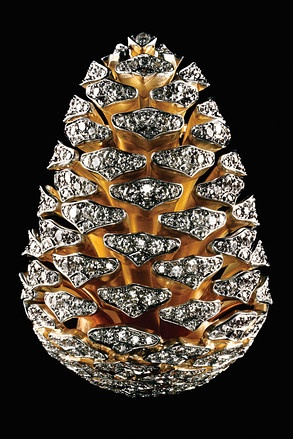 """Verdura's Pinecone brooch, 2009. """"It took two years to research and eight months to make the brooch. A team of jewelers assembled 39 pieces of gold and platinum, and 10.27 carats of round-cut diamonds to create a pinecone slightly smaller than the original. To make the scales, artisans used tools coated on the inside with soft copper to protect the surface. $96,500"""" Photographs by Christopher Griffith"""