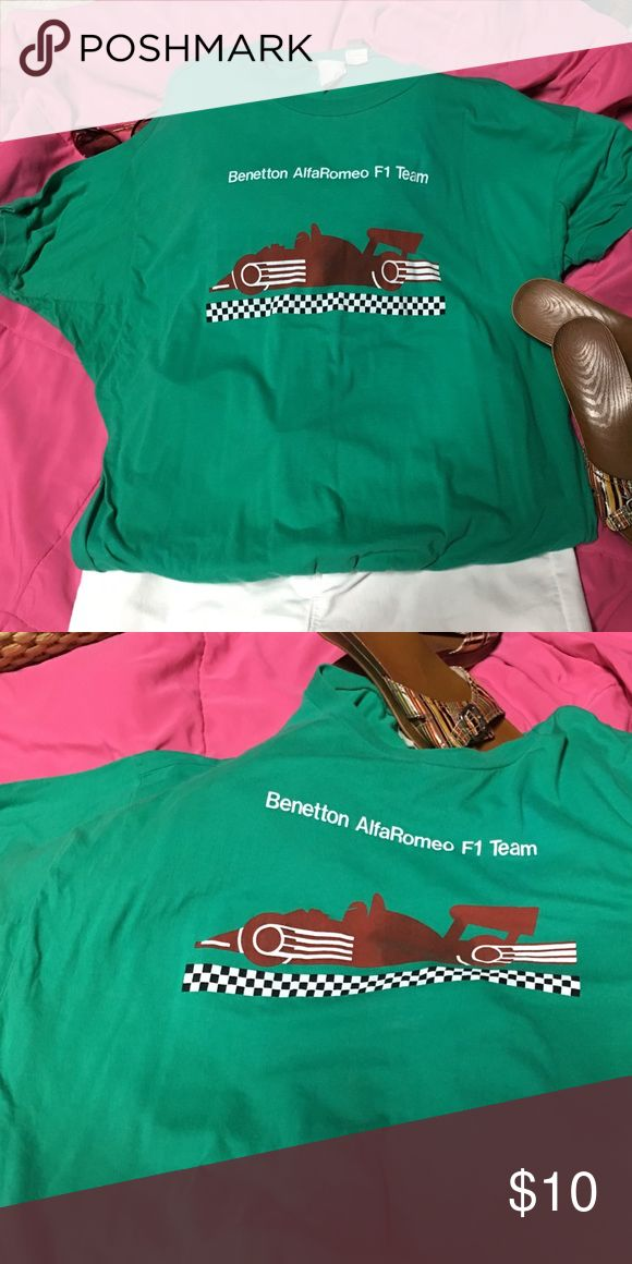 Benetton AlfaRomeo F1 Team Vintage T-Shirt Size L This t/shirt was purchased in the mid 80's. It has a banded was and semi dolman short sleeves. There is some discoloration on the race car, but no rips or pilling. Benetton Tops Tees - Short Sleeve