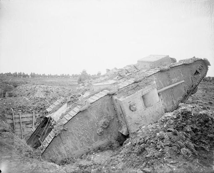 BATTLE ARRAS 1917 (Q 6427)   A British tank ditched in a captured German gun pit during the Battle of Arras. British cavalry can be seen massed in the background.