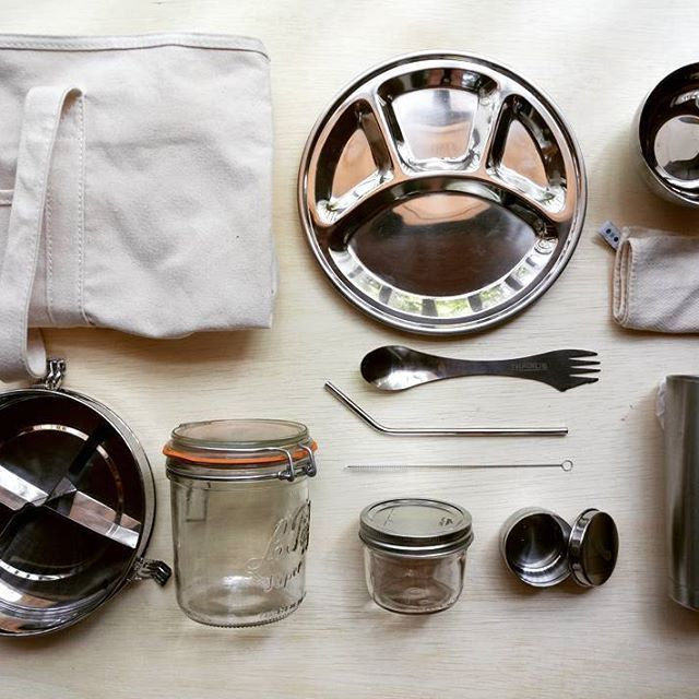 Zero waste kit for keeping in your car   Staying zero waste on the go   Stainless steel plates, reusable cutlery, Le Parfait jar, and stainless steel straw