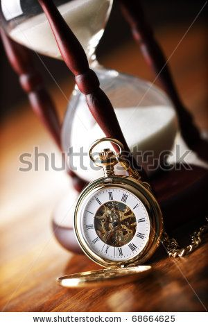Hour glass or sand timer with vintage pocket watch.  Downloadable for free from Shutterstock.
