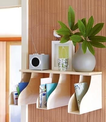 Wooden magazine holders screwed to the wall and topped with a shelf