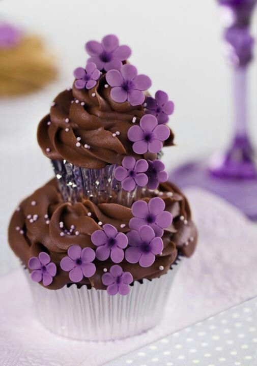 Cute layered cupcake with purple small flowers