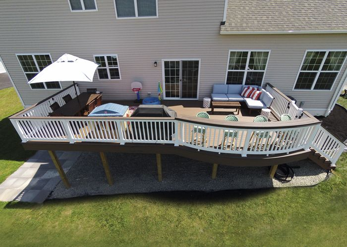 Custom TimberTech Deck, West Chester PA - Keystone Custom Decks This custom deck was built with TimberTech Brown Oak decking and White Vinyl handrails with a Walnut Grove top rail. This space features a one of a kind curved bar area along with a complete lighting package. This space was completed in the early months of 2015 and the homeowners are thrilled with the outcome. Project Id #057 Sq Ft: 496 Color: Brown Oak Price Range: $15,000 - $20,000 Manufacturer: TimberTech