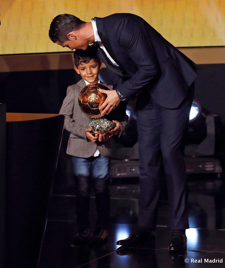 FIFA Ballon d'Or winner Cristiano Ronaldo of Portugal and Real Madrid gives the trophy to his son during the FIFA Ballon d'Or Gala 2014 at the Kongresshaus on January 12, 2015 in Zurich, Switzerland.