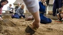 Children taking part in an archaeological dig
