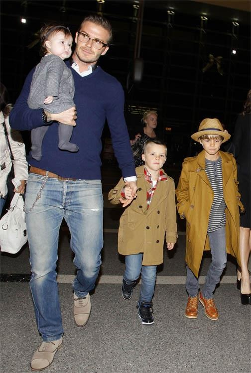 This is pretty much my family scene, just minus the beckhams- insert my own little brood!