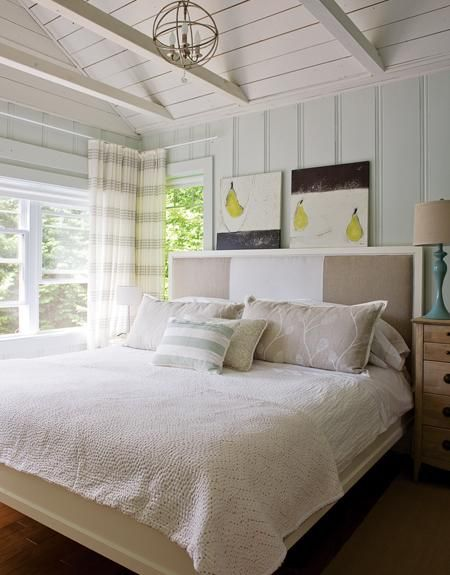 Parkdale Ave.perfect little summer cottage on Maison et Demeure.   It's located in the Laurentians and everything about it just screams my name!   I  love the exposed beams,  knotted pine flooring and wood paneled walls.   It's not very big,  it isn't overdone nor glamorous but it's welcoming and loaded with personality.  The kitchen is narrow but feels rather spacious due to the use of white cupboards,  simple backsplash and big window.