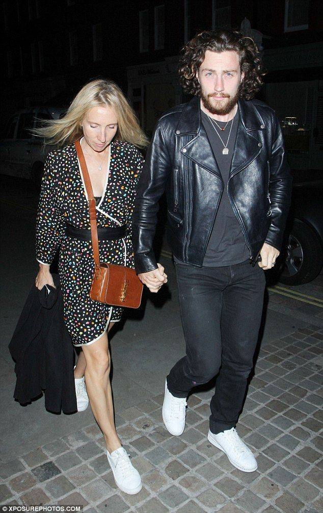 Loved-up: Aaron Taylor-Johnson and his wifeSam Taylor-Wood stepped out in London on Tuesd...