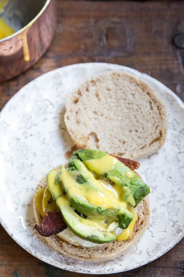 Eggs Benedict taken to the next level with bacon and avocado! Also, a recipe for fool-proof hollandaise sauce.  #brunch #breakfast