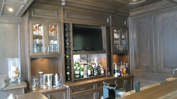 Custom wet bar in oak with appliances and tv built in - Built in home bar ...