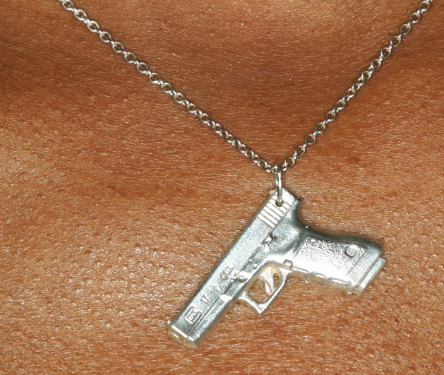 Glock 17 necklace. So awesome. I can still be a girly girl and shoot glocks! =D Save those thumbs & bucks w/ free shipping on this magloader I purchased mine http://www.amazon.com/shops/raeind   No more leaving the last round out because it is too hard to get in. And you will load them faster and easier, to maximize your shooting enjoyment.