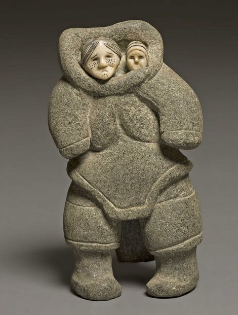 Sheokjuk Oqutaq - Mother and Child, 1952 - Stone, ivory, black colouring. Collection of the Winnipeg Art Gallery. The Ian Lindsay Collection. Acquired with funds from the Volunteer Committee to the Winnipeg Art Gallery. G-85-307