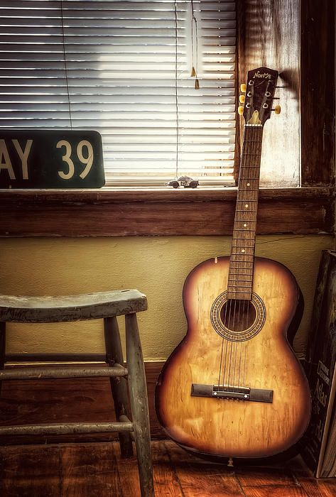 This old guitar was in one of the rooms at the Lucky Dog Farm Stay bed and breakfast in New Glarus, Wisconsin. There is something so warm and inviting about and old beat up guitar sitting in the corner, Kind of like a long lost friend. Enjoy!