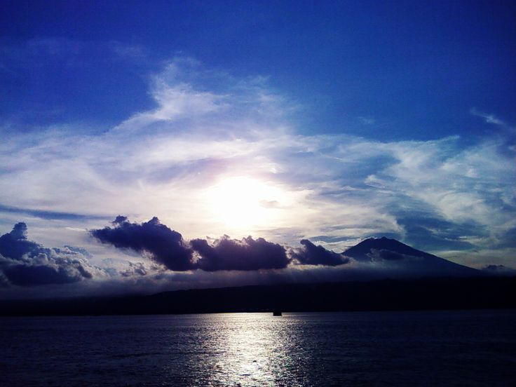The Sun, Sea, Mountain, and Clouds in one pic by Yusuf Fahmi Adiputera on 500px