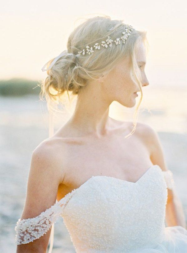Loose bridal bun hairstyle and off the shoulder beaded wedding dress