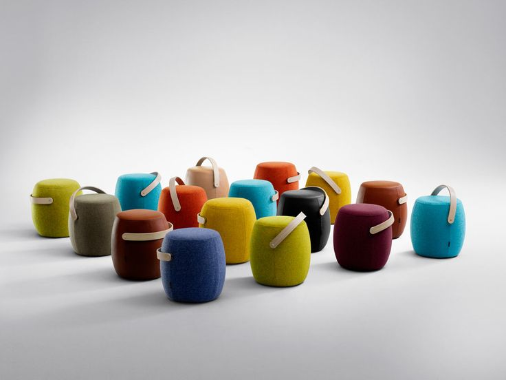 A portable, fabric-covered, colorful stool with a handle that you can lug around your home or office for those times you need extra seating.
