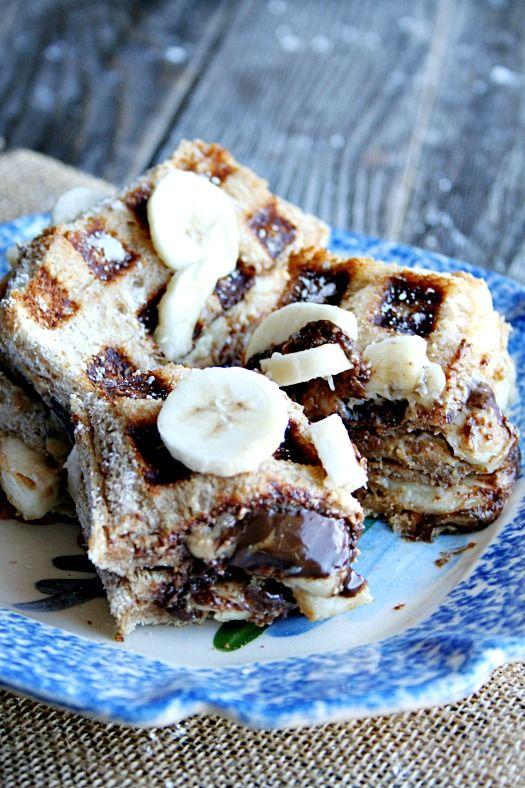 Nutella, Peanut Butter, and Banana stuffed French Toast Waffles - heathersfrenchpress.com #breakfast#nutella