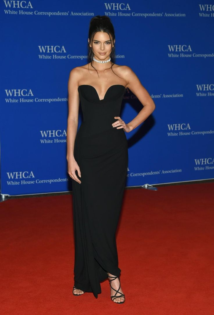 Bringing her model skills to the red carpet, Kendall Jenner struted onto the red carpet in a black Vivienne Westwood dress as she arrives to the White House Correspondents' Association Dinner at the Washington Hilton Hotel on April 30, 2016.