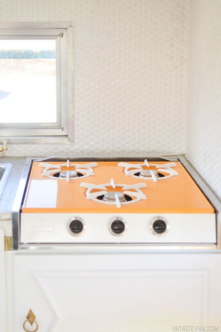 """Powder Coated Stovetop. Total cost for [professional] powder coating was $79.00 """"You CAN DIY a new stove top color.  ish.  Rustoleum makes high heat spray paint that will absolutely work in this situation.  The colors are limited but they do have white and a really good copper (this was my backup plan)."""""""