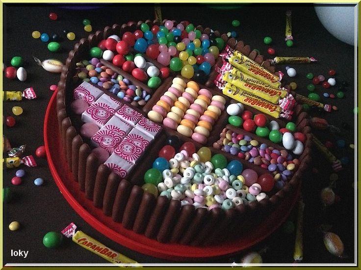 Quand Loky kid veut un gâteau de bonbons Loky Mum s'exécute !!!.. Voilà ce que cela donne un gâteau au chocolat moelleux à souhait et des bonbons ingredients : 300g de chocolat 1/2 verre de lait 150g de sucre 4 oeufs 150g de farine 75g de beurre coupé...