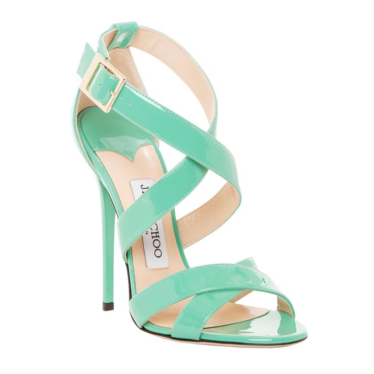 Add a touch of pretty pastels to your shoe collection with these mint green Jimmy Choo sandals. Made with patent leather, these sandals showcase criss-cross straps and a buckle closure.