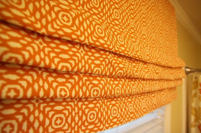 This is a tutorial for a FIXED flat-fold roman shade. Meaning, the pleats are fixed, but the look is really cute. SUPER simple sewing project!