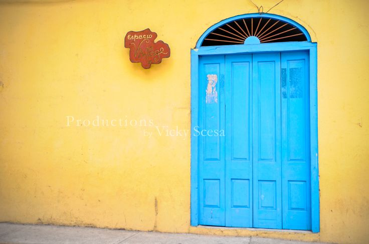 """""""Espacio Vintage Door, Panama City"""" by Vicky Scesa was captured in the Old Quarter (also known as Casco Viejo) of Panama, Republic of Panama.This premium photographic print is digitally printed on Premium Lustre Photographic Paper for gallery quality display. Under options, there are many available choices for print sizes and matting. Please use the contact form for special requests i.e. Mat colors and additional sizesAll watermarks are removed prior to printin..."""