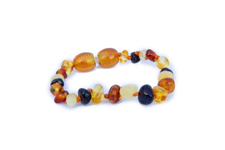 Childrens Amber Bracelet - Multicoloured Baroque by Amberocks. Amber teething bracelets are designed with the younger babies in mind. Each bead is individually knotted so if the bracelet was to break, only one bead would come free. The screw clasp is designed to break under stress. These can be worn against the skin around the wrist or ankle, and safely tuck away under clothing, perfect for when baby is asleep.