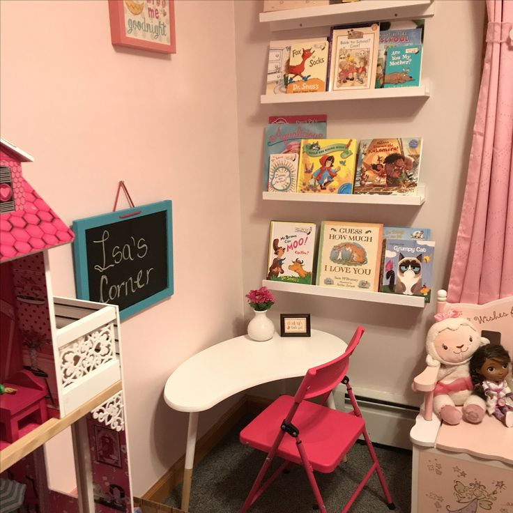 A little make over to our toddler's reading corner... She's growing, so a more appropiate learning space was needed.  Still making the best use of the small room corner here; While repurposing and painting an old chalkboard, scoring a find with a small accent table turned mini desk, purchasing an economical yet comfy chair.  The result, a happy little girl and two proud parents.