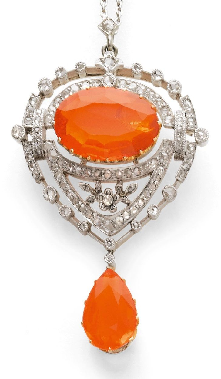 A BELLE EPOQUE FIRE OPAL AND DIAMOND PENDANT, CIRCA 1910. The pendant set with…
