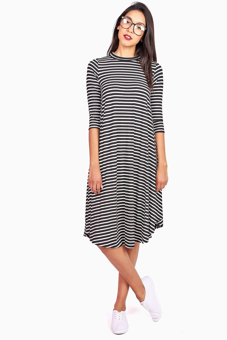 """Casual t- shirt dress with a fitted neckline and half length sleeves. Stretchy ribbed fabric flares into an A-line midi dress. *Hand Wash Cold *80% Polyester 18% Rayon 2% Spandex *41.5""""/105cm Top to B"""