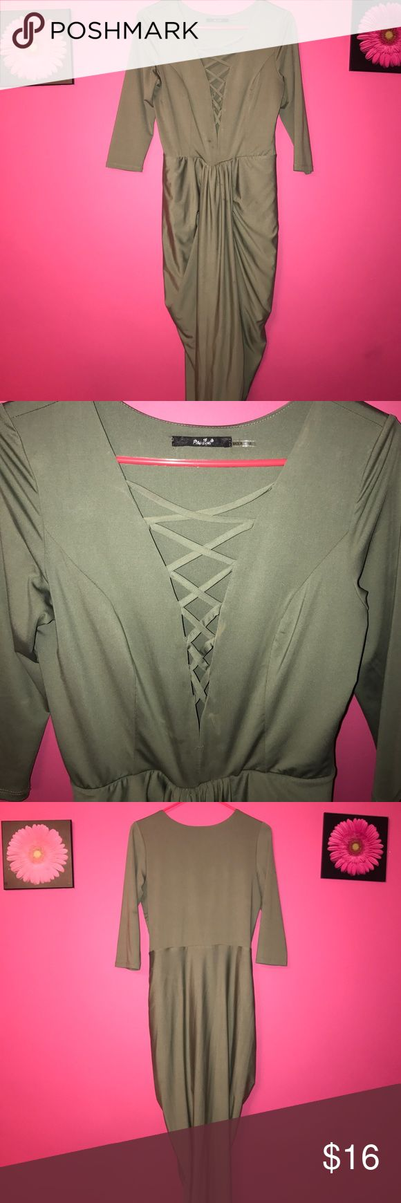 Green tight fitting dress Very cute green lace up top dress! Worn once, perfect condition! Quarter sleeve, tight fitting. Goes down to my ankles! Dresses Midi