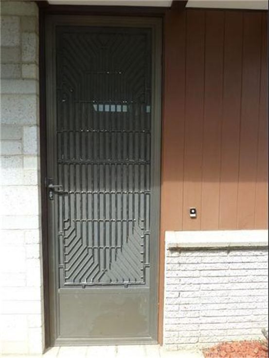 Mid-Century Modern security screen door by Secret Design Studio. We are a design-focused building consultancy, based in Melbourne, Australia. We are passionate about quality residential design. We collect 20th Century chairs. We champion mid century modern architecture with an irregular blog. Follow us on https://www.facebook.com/SecretDesignStudio or twitter @Secret_Design. www.secretdesignstudio.com