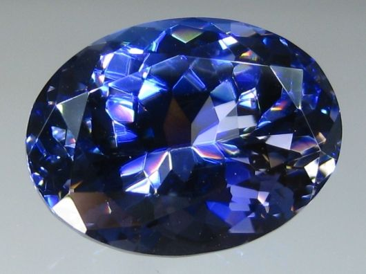 Benitoite - In 2007, the owner of the Benitoite Gem Mine discovered a near flawless crystal weighing just over 34 carats. The crystal was faceted into 4 gemstones, the largest of which is this beauty. This is the 4th largest faceted VVS or better Benitoite for the species. Weight: 8.06 ct., Origin: San Benito County, California USA, Size: 13.82 mm x 10.44 mm x 7.35 mm, Color: Dark Blue, Violet, Shape: Oval, Modifed Brilliant Cut, Treatment: None, 100% natural