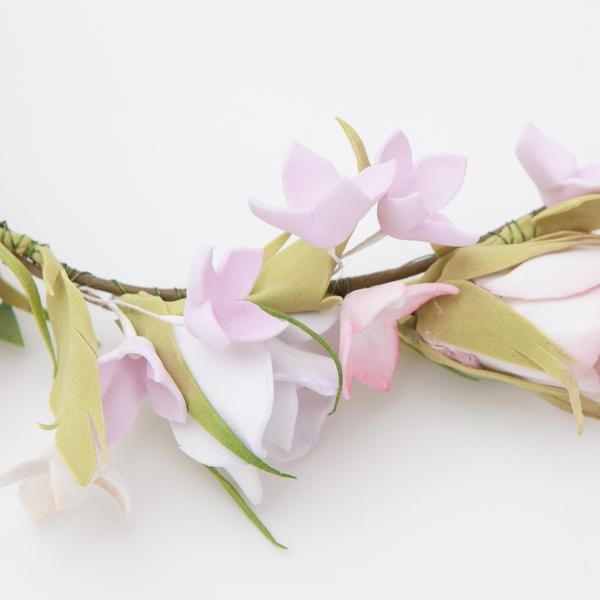 Pink spring flowers head wreath closeup