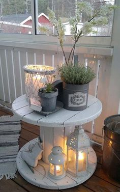Creating a fantastic outdoor retreat is not that hard: pick cute wooden furniture to storage your belongings, sofas and armchairs will help you achieve a comfortable retreat, put colourful flowers in original vases like apple crates, create a cosy atmosphere with candles...