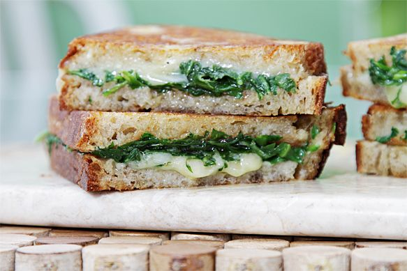 Grilled Cheese Sandwich with Garlic Confit and Baby Arugula. Recipe from Food & Style. http://foodandstyle.com/2011/03/21/grilled-cheese-sandwich-with-garlic-confit-and-baby-arugula/