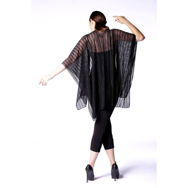 This evening shawl is created with a soft woven fabric embellished with sparkling accents. Wear it as a shoulder wrap, or as a neck scarf and shimmer away!  Content: 90% Viscose, 10% Metallic Yarn