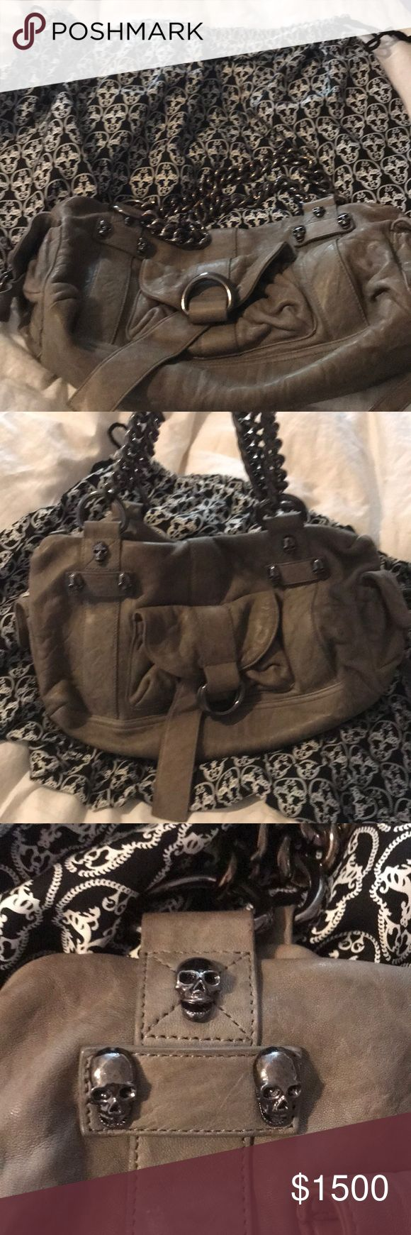 Authentic Thomas Wylde lambskin skull bag authentic gray thomas wylde skull bag! It is lambskin! It comes with the dust bags! Has gorgeous skull detail as well as the classic chain hardware! This bag is for a true rockstar! It has an inside pocket as well two side pockets and one front pocket  Dimensions 16x8x6.5 Thomas Wylde Bags Shoulder Bags